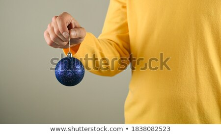 old man with an ornamented christmas ball Stock photo © nito