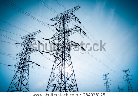 Stockfoto: Electrical Transmission Towers Electricity Pylons At Dusk
