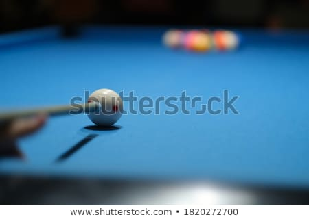 Person playing snooker (focus on the first ball) Stock photo © pedromonteiro