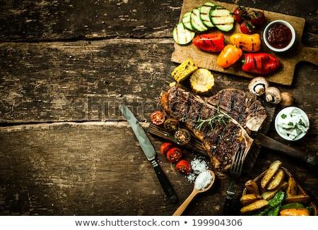 overhead view of colorful roast vegetables savory sauces served stock photo © yatsenko