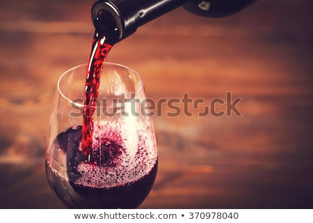 Red wine glass and bottle Stock photo © karandaev
