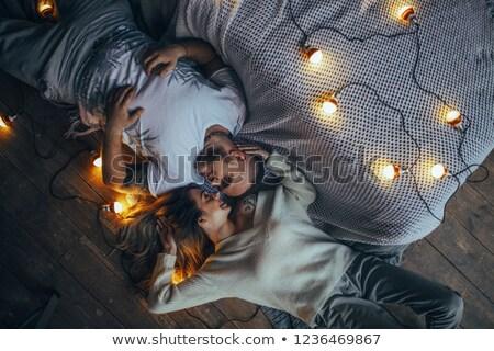 Gyönyörű pár hazugságok padló gyengéd csukott szemmel Stock fotó © bezikus
