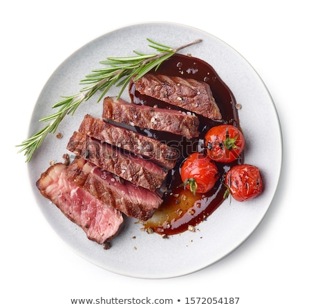 pieces of raw meat on a white plate stock photo © kayros
