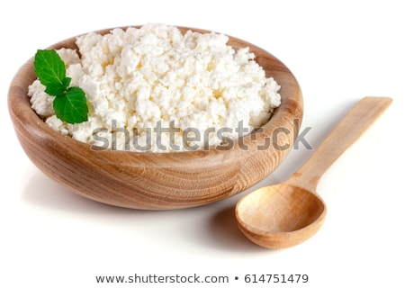 Cottage cheese on white wooden rustic background, dairy product Stock photo © yelenayemchuk