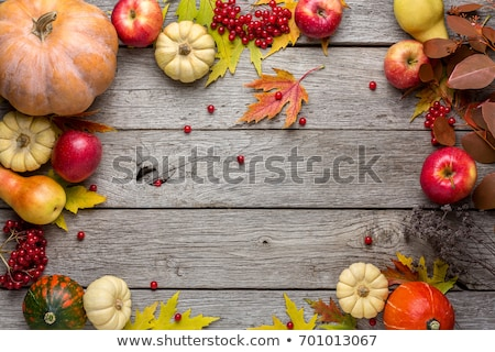 autumn background with leaves and pumpkins, thanksgiving and halloween card stock photo © yelenayemchuk