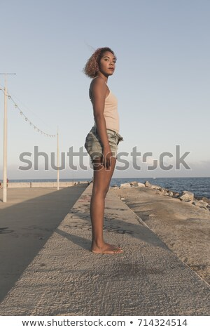 African American Woman Standup In Shorts On Beach Stockfoto © 2Design