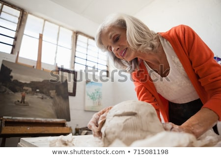 Attentive senior woman shaping a molded clay Stock photo © wavebreak_media
