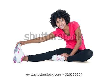 Young woman touching toes while exercising Stock photo © wavebreak_media