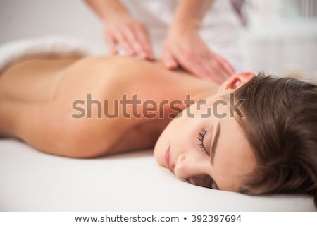 Woman in front of a massage table Stock photo © IS2