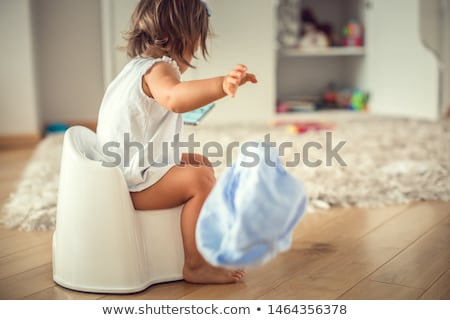kid with a phone on the potty Stock photo © Traimak