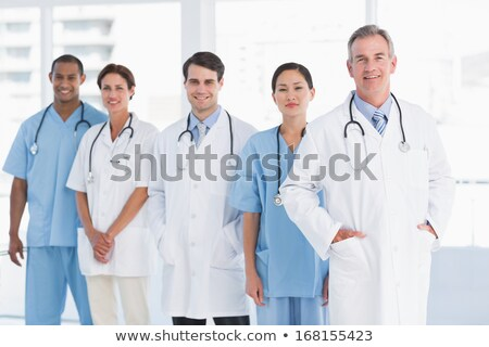 a portrait of three doctors smiling stock photo © is2