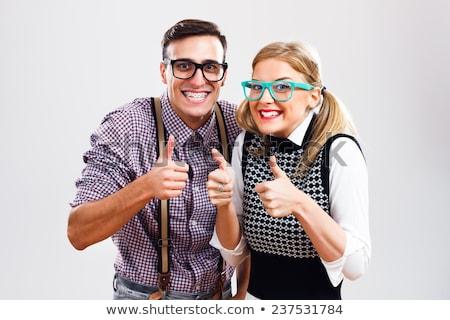 Gelukkig glimlachende vrouw bretels tonen gebaar Stockfoto © dolgachov