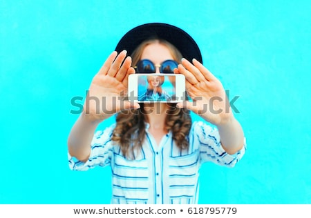 Teenage girl taking photo on phone Stock photo © IS2
