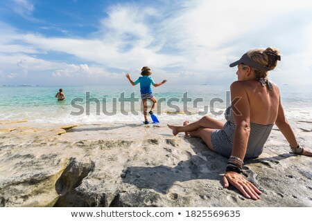 mature woman with child on rocks Stock photo © IS2