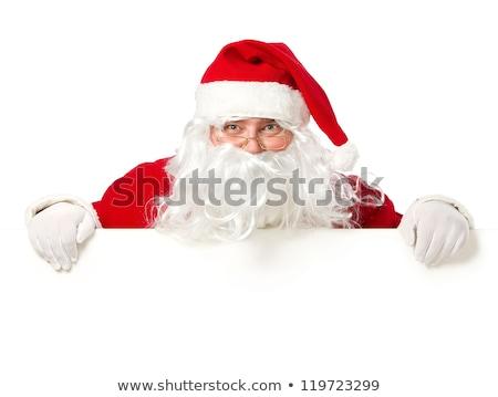 santa claus hiding behind a blank board stock photo © feedough