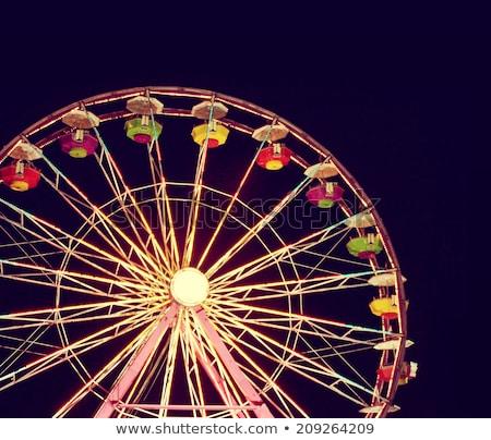 óriáskerék · mozgás · izzó · éjszakai · ég · kerék · megvilágított - stock fotó © is2