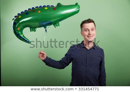 男 インフレータブル ワニ 楽しい おもちゃ 笑みを浮かべて ストックフォト © IS2