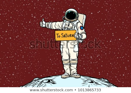 Stock photo: Astronaut hitch rides on Saturn