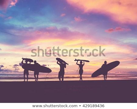 Surfer пляж доска для серфинга влажный песчаный пляж закат Сток-фото © joyr