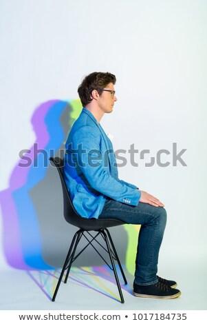 портрет молодым человеком сидят Председатель рук вниз Сток-фото © deandrobot