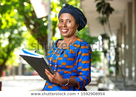 africano · empresária · em · pé · documentos · mão · corporativo - foto stock © studioworkstock