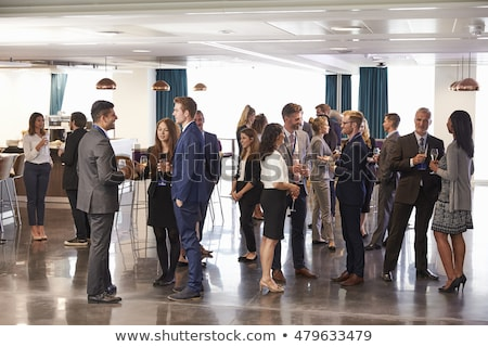 a middle eastern and caucasian woman talking at a business meeti stock photo © monkey_business