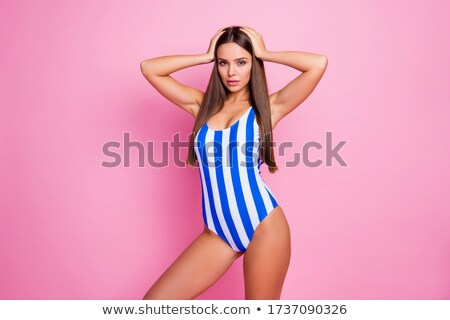 Content pretty woman posing confidently on beach Stock photo © dash