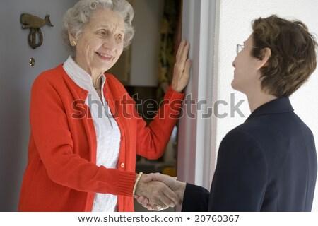 Nők beszél kapualj fa mosolyog boldogság Stock fotó © IS2