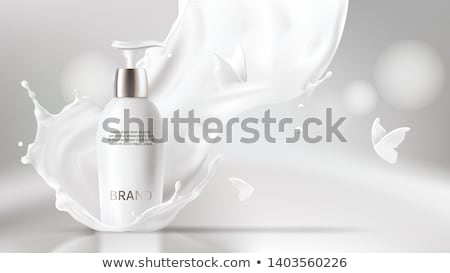 pouring lotion from the bottle stock photo © magraphics