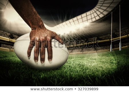 rugby player holding rugby ball stock photo © is2