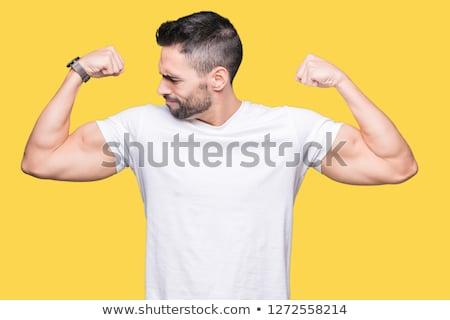 fiatal · férfi · mutat · bicepsz · ököl · kéz - stock fotó © imabase