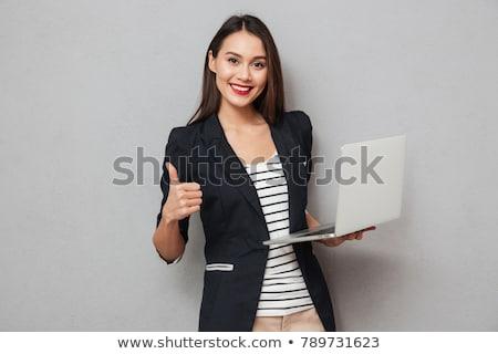gelukkig · brunette · vrouw · jas · laptop · computer - stockfoto © deandrobot