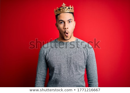 Portrait of a shocked man standing over red background Stock photo © deandrobot