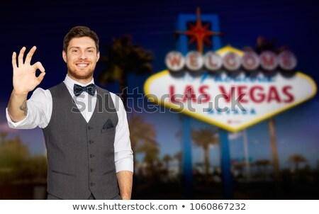 Fiatalember öltöny mutat ok felirat Las Vegas Stock fotó © dolgachov