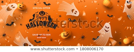Stock photo: Happy Halloween banner illustration with scary faced pumpkins and flying bats on orange background.