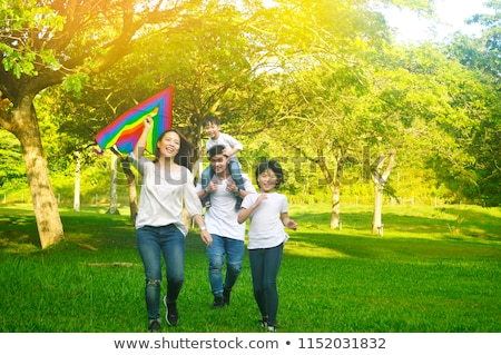 Family Playing With The Colorful Kite Stock photo © AndreyPopov
