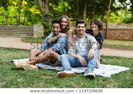 Felice giovani amici esterna parco Foto d'archivio © deandrobot