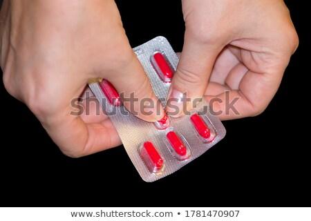 Kadın eller açılış paketlemek tıp kapsül Stok fotoğraf © dolgachov