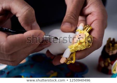 man painting figurines of a nativity scene stock photo © nito