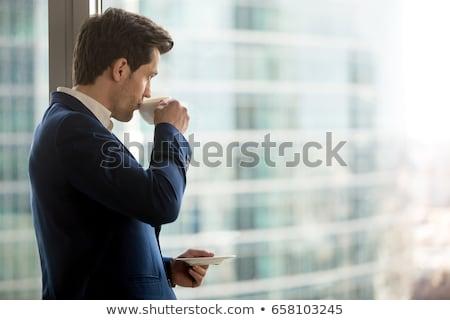 gelukkig · zakenman · naar · smartphone · jonge - stockfoto © deandrobot