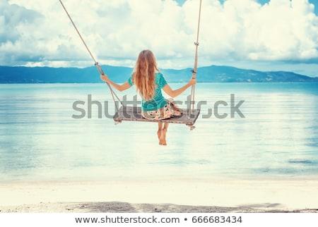 Vrouw tropisch strand silhouet touw swing zonsondergang Stockfoto © NeonShot