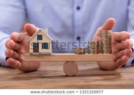 üzletember · modell · otthon · érmék · arany · mérleg - stock fotó © andreypopov