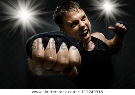 angry warrior in action stock photo © jossdiim