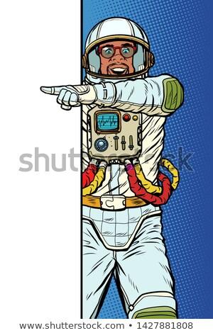 man astronaut. Point to copy space poster Stock photo © studiostoks