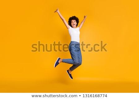Tam uzunlukta görüntü mutlu kadın kot Stok fotoğraf © deandrobot