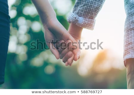happy and affectionate senior couple holding by hands stock photo © pressmaster