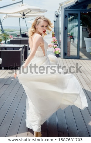Fashion model bride with long flowing blonde hair and makeup Stock photo © serdechny