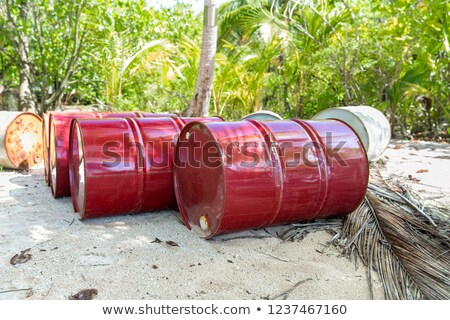 oil drum barrels on beach in french polynesia Stock photo © dolgachov