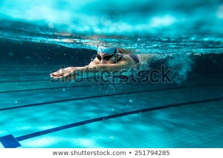 женщину · плаванию · подводного · бассейна · улыбаясь · молодые - Сток-фото © kzenon
