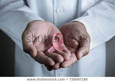 Doctor man with breast cancer awareness ribbon Stock photo © wavebreak_media